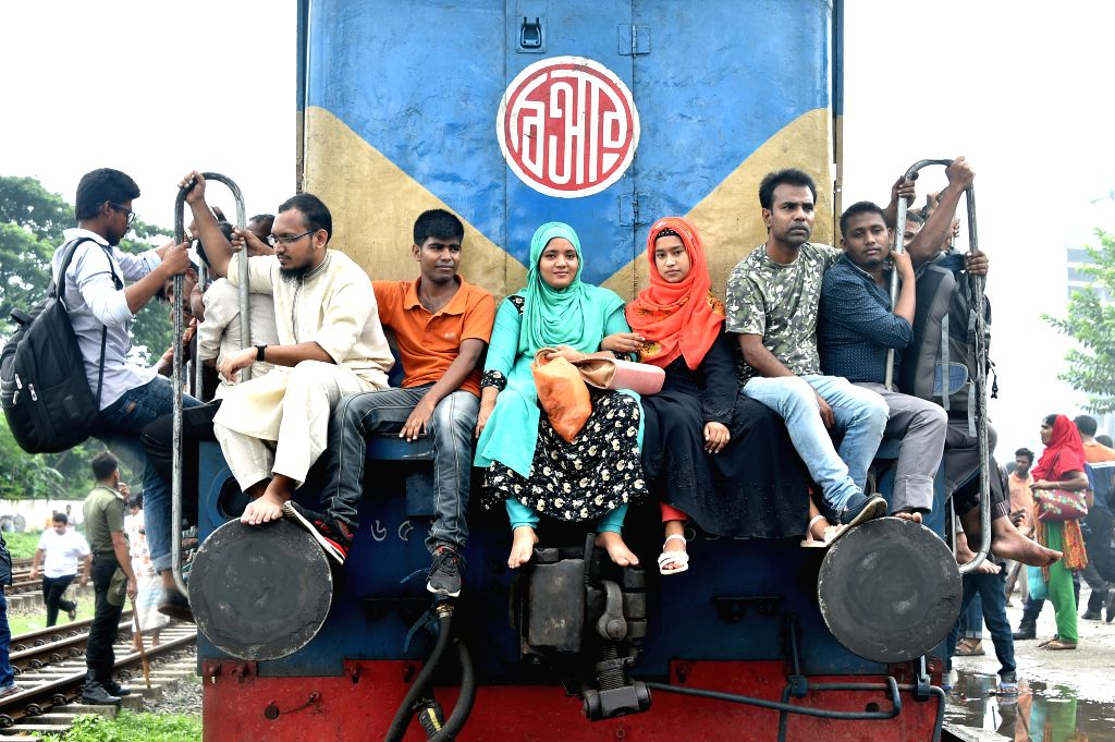DHAKA, Aug. 10, 2019 - Passengers are seen on an overcrowded train ahead of the Eid al-Adha holiday in Dhaka, capital of Bangladesh, on Aug. 9, 2019. With the Eid al-Adha holiday approaching, ...