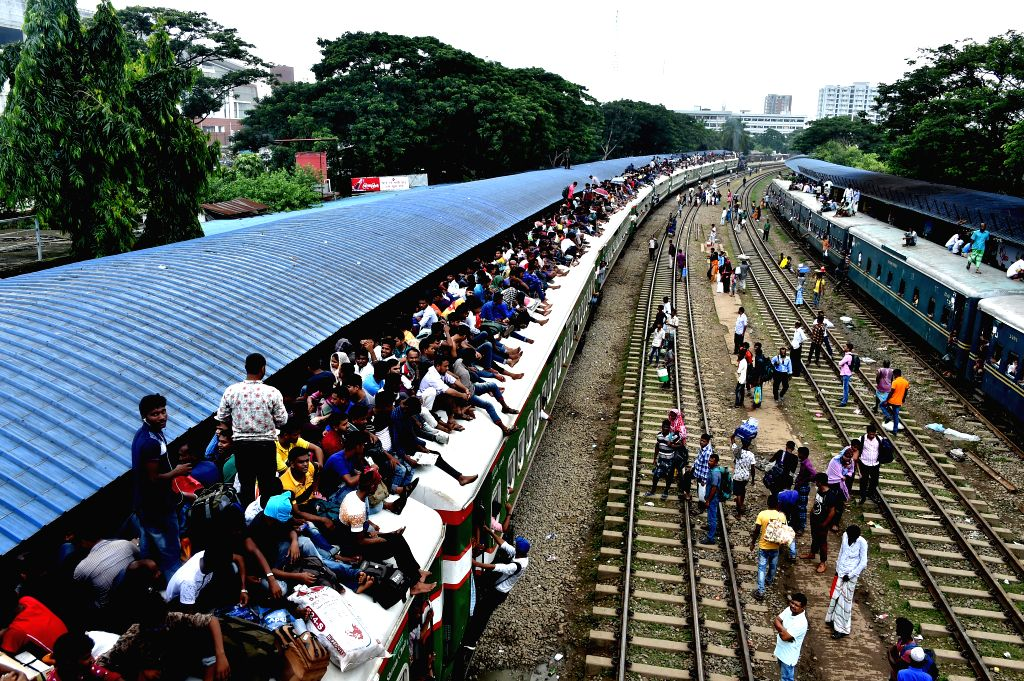 DHAKA, Aug. 10, 2019 - People climb up a train at a railway station ahead of the Eid al-Adha holiday in Dhaka, capital of Bangladesh, on Aug. 9, 2019. With the Eid al-Adha holiday approaching, ...