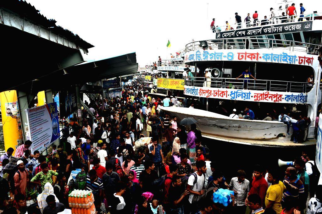 DHAKA, Aug. 10, 2019 - Travelers crowd into Sadarghat Launch Terminal in Dhaka, Bangladesh, Aug. 10, 2019. With the Eid al-Adha holiday approaching, hundreds of thousands of Bangladeshi capital ...