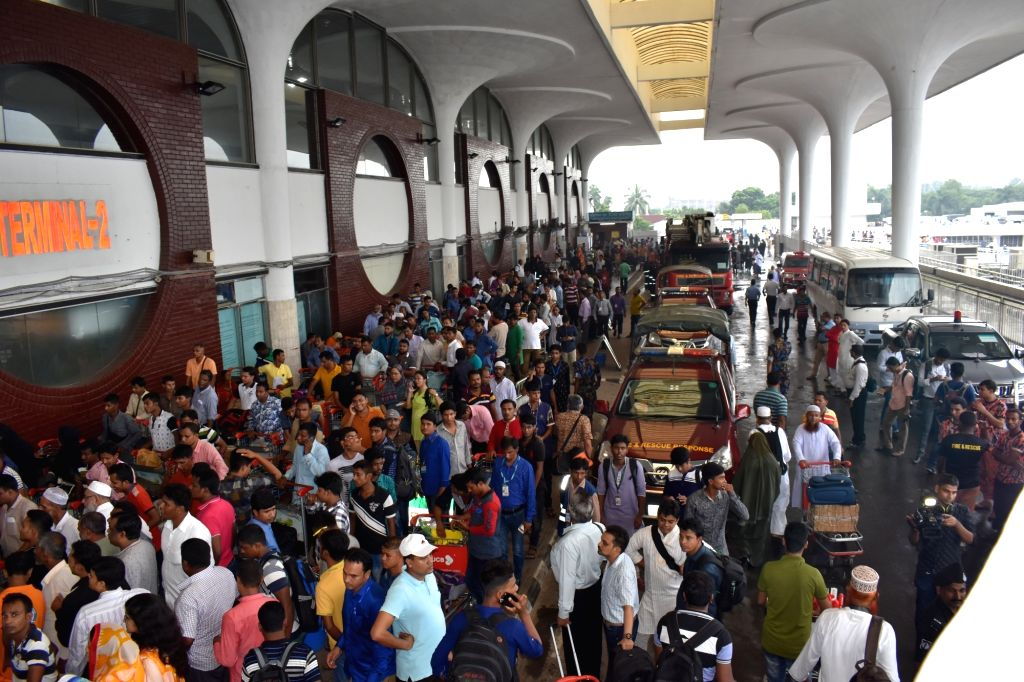 DHAKA, Aug. 11, 2017 - Passengers are evacuated at Bangladesh's Hazrat Shahjalal International Airport in Dhaka, Bangladesh, Aug. 11, 2017. The fire that broke out Friday afternoon in a building ...