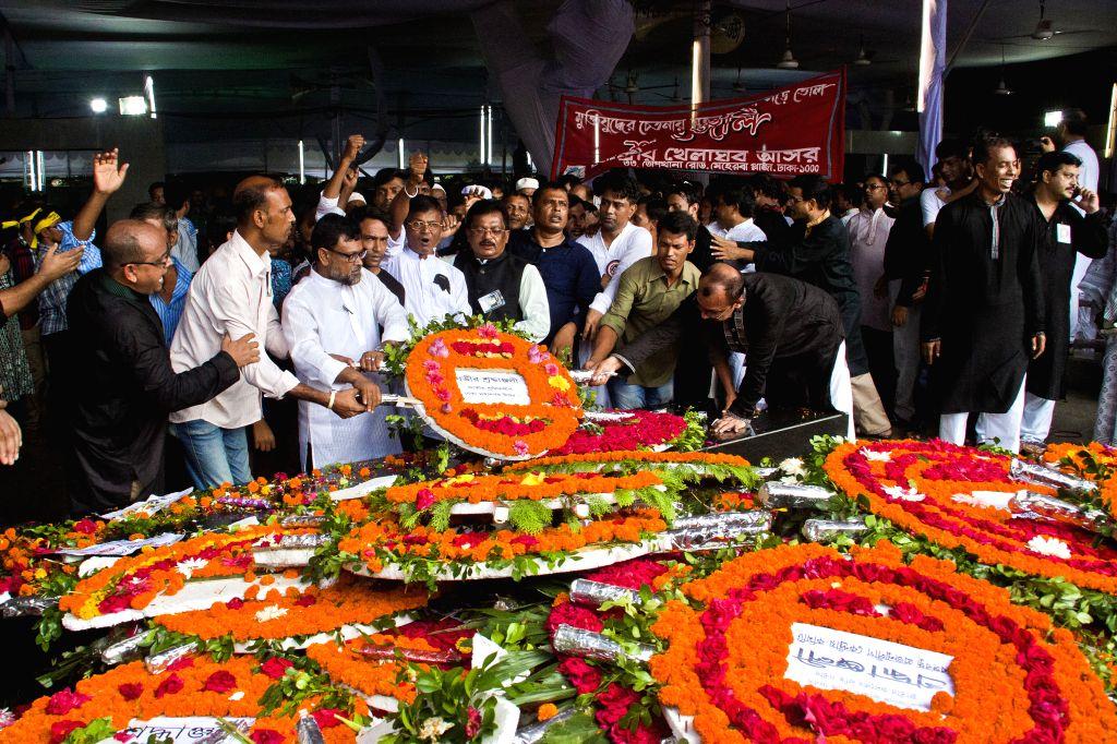 DHAKA, Aug. 15, 2016 - Bangladeshi people offer floral tributes during a commemoration of Bangladesh's founding father and first president Sheikh Mujibur Rahman in Dhaka, Bangladesh, Aug. 15, 2016. ...