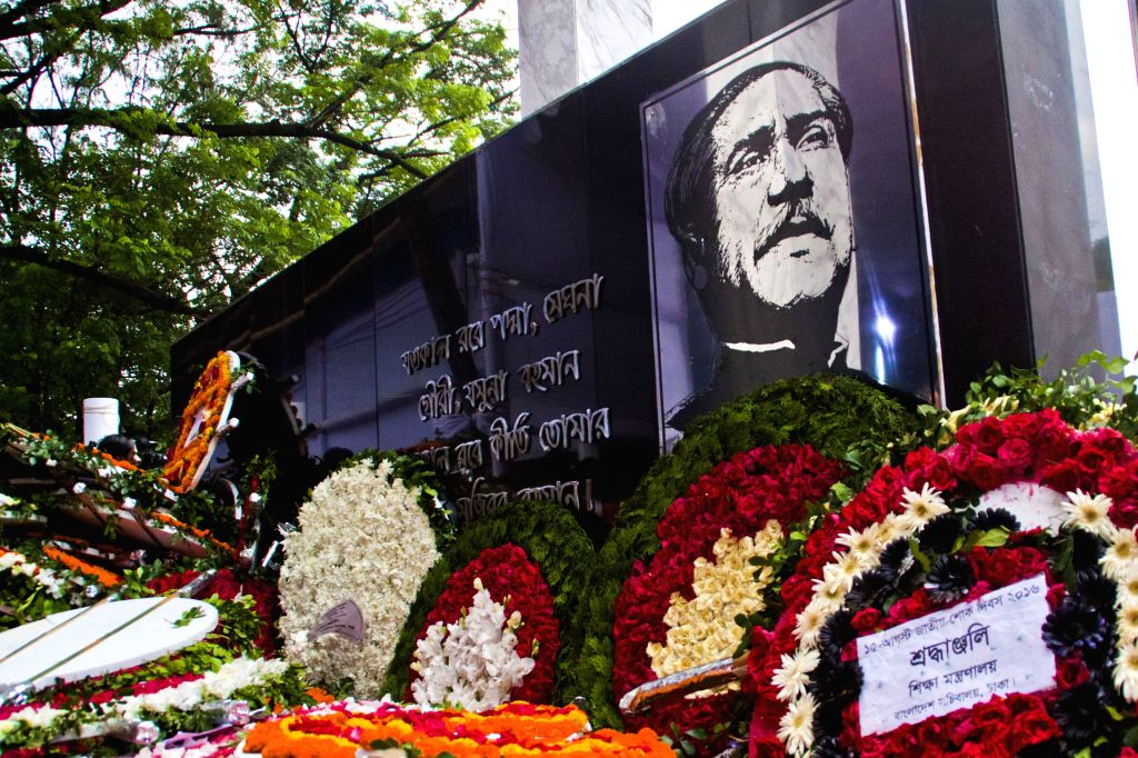 DHAKA, Aug. 15, 2016 - Photo taken on Aug. 15, 2016 shows floral tributes during a commemoration of Bangladesh's founding father and first president Sheikh Mujibur Rahman in Dhaka, Bangladesh. The ...
