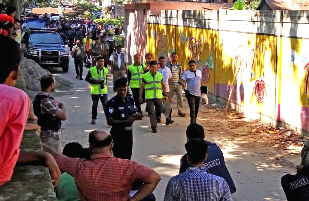 DHAKA, Aug. 27, 2016 (Xinhua) -- Security personnel enter a house where a gun battle with militants happened on the outskirts of Dhaka, Bangladesh, Aug. 27, 2016. The suspected mastermind of last month's deadly cafe attack that killed 22 was among th