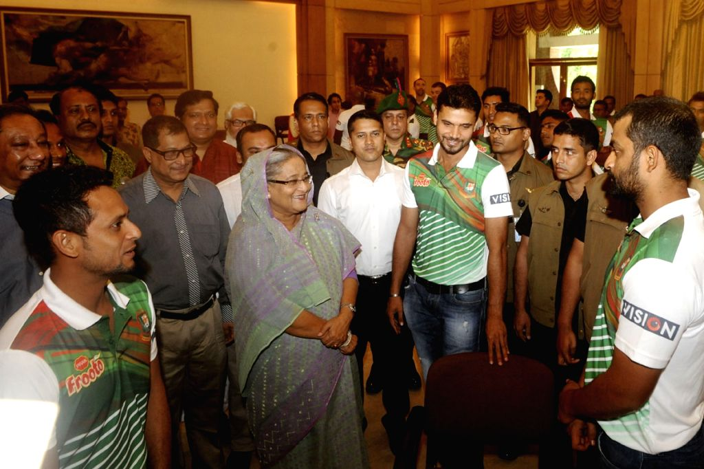 Bangladesh Prime Minister Sheikh Hasina greets Bangladesh cricket team during a reception in Dhaka, Bangladesh on April 25, 2015. The Prime Minister has announced to flats and cars for the ...