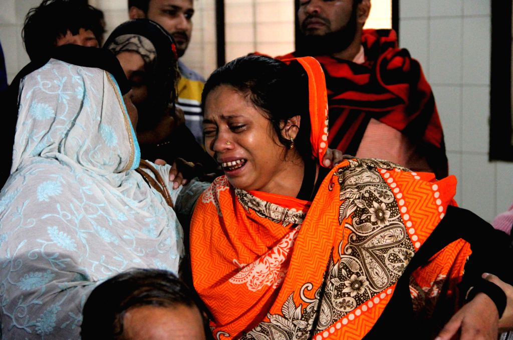 DHAKA, Dec. 12, 2019 - Relatives of plastics factory fire victims wail at Dhaka Medical College Hospital in Dhaka, capital of Bangladesh, Dec. 12, 2019. At least 13 people have died in a devastating ...