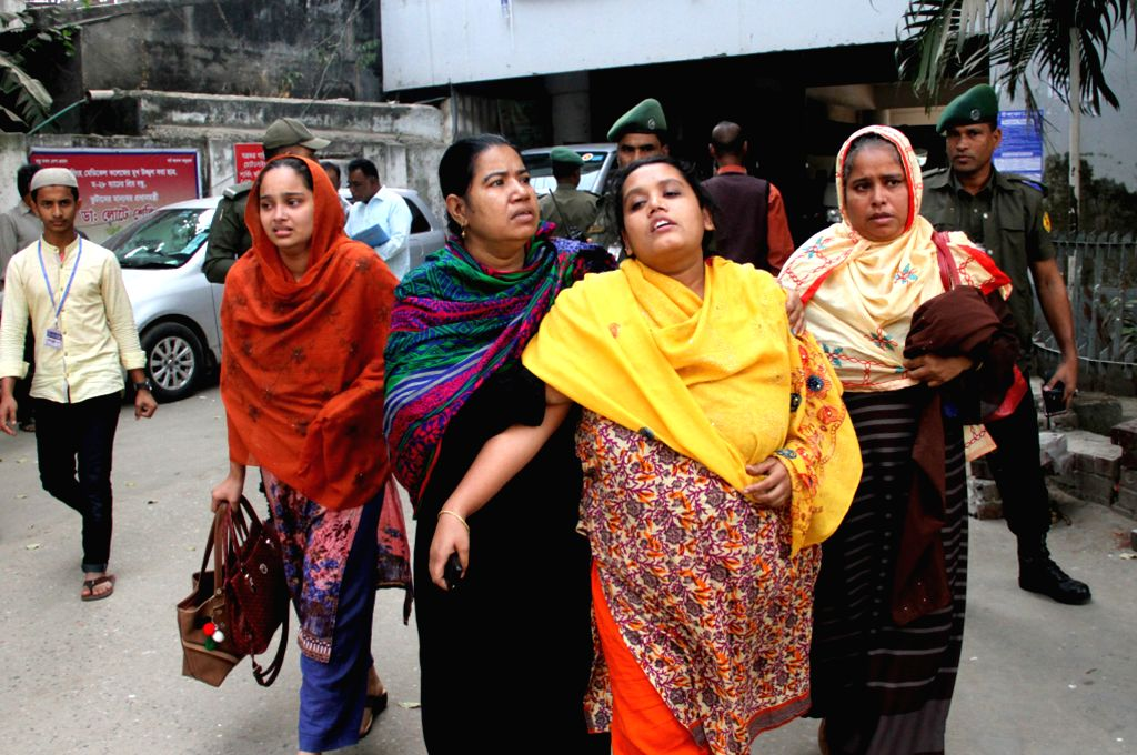 DHAKA, Dec. 12, 2019 - Relatives of plastics factory fire victims are seen at Dhaka Medical College Hospital in Dhaka, capital of Bangladesh, Dec. 12, 2019. At least 13 people have died in a ...