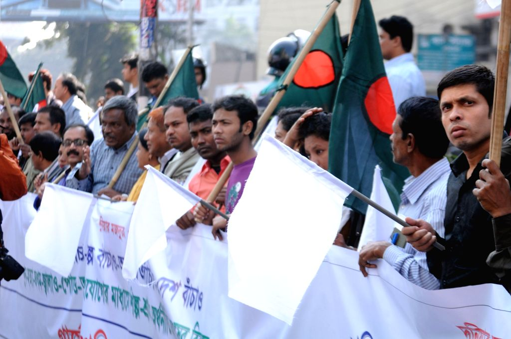 Bangladeshi businessmen stage white flag rallies as they demanding peaceful business environment during the dawn-to-dusk hartal called by Jamaat-e-Islami party ..