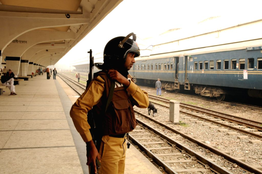 A security member stands guard at the Komlapur railway station during the 72-hour country wide road-rail-waterway blockade in Dhaka, capital of Bangladesh, on ...