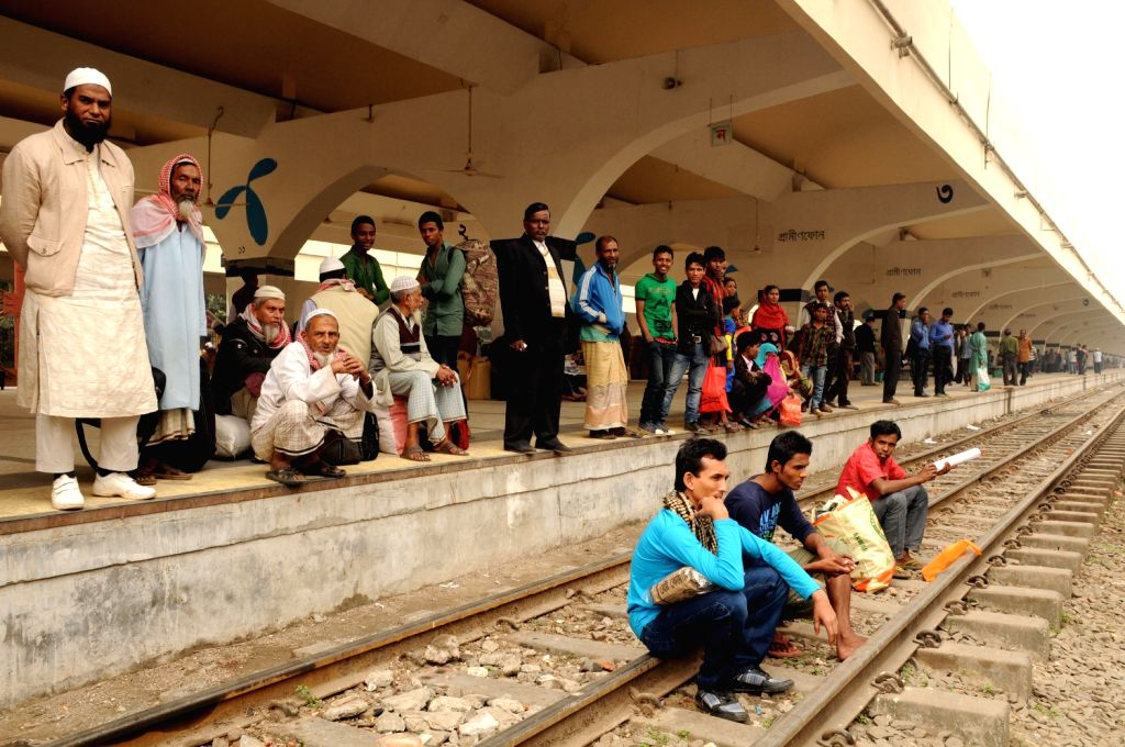 People wait for trains at the Komlapur railway station during the 72-hour country wide road-rail-waterway blockade in Dhaka, capital of Bangladesh, on Dec. 19, ..