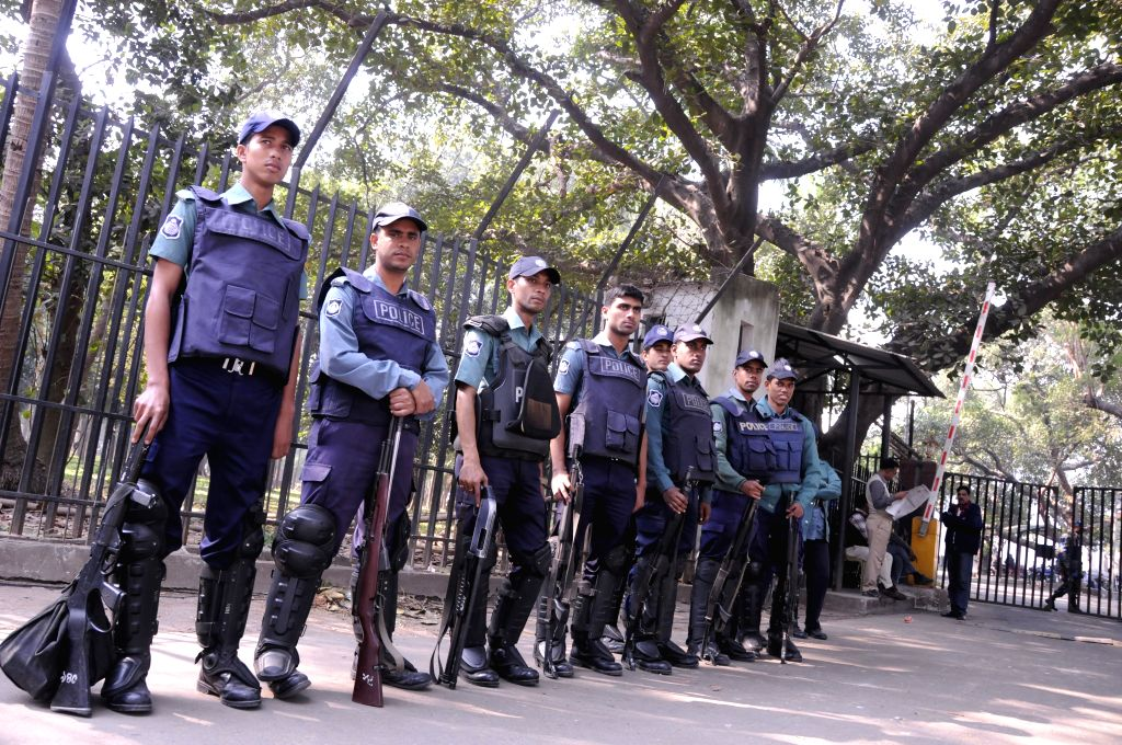 Bangladeshi police stand guard in front of the Supreme Court during a verdict announcement in Dhaka, Bangladesh, Dec. 23, 2014. Bangladesh's International Crimes ... - Syed Mohammed Kaiser