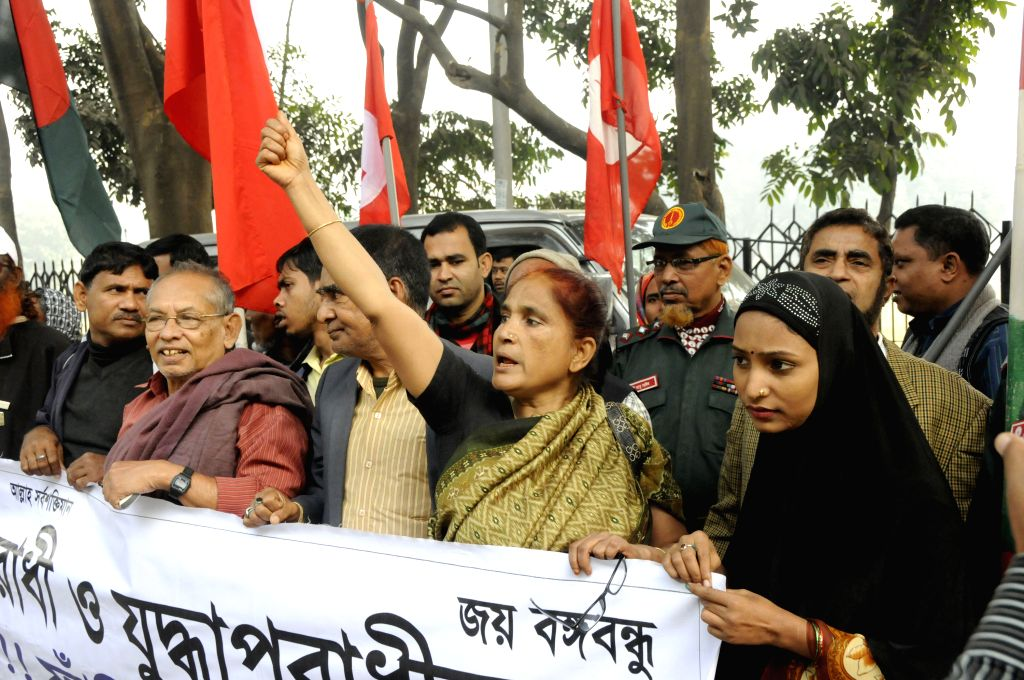 Bangladeshi activists shout slogans during a protest rally to demand capital punishment ahead of pronouncement of verdict announcement in Dhaka, capital of ...