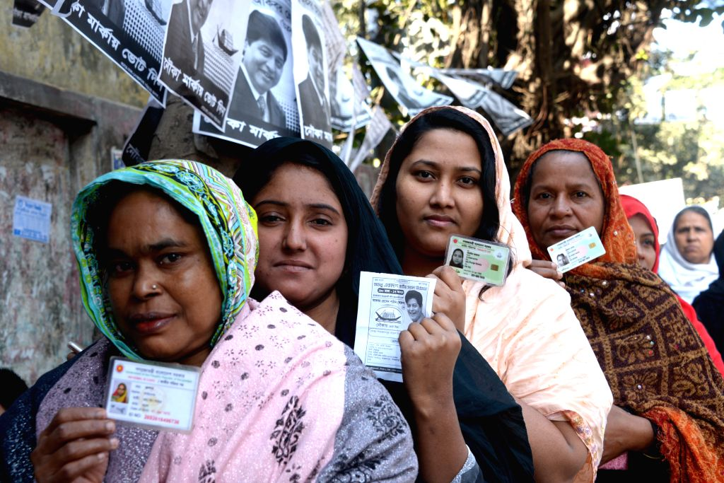 DHAKA, Dec. 30, 2018 (Xinhua) -- Voters line up at a polling station in Dhaka, Bangladesh, Dec. 30, 2018. Nationwide voting opened Sunday morning in Bangladesh's general elections to elect hundreds of representatives to parliament amid reports of str
