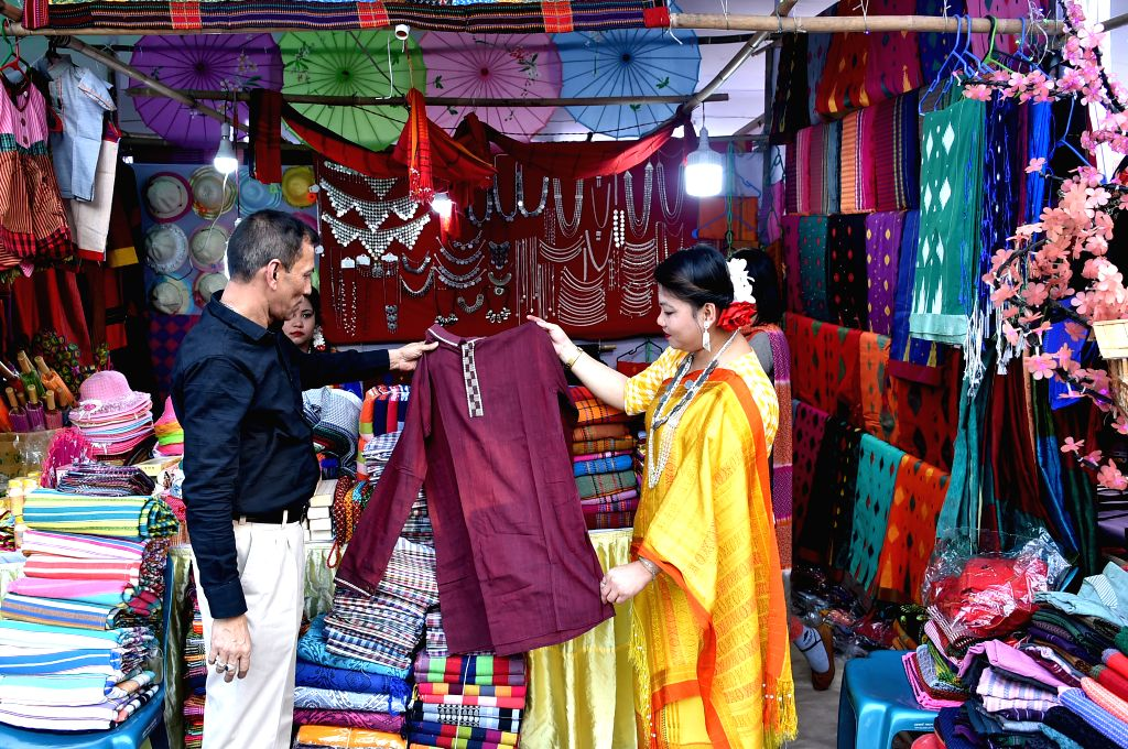DHAKA, Dec. 6, 2019 - Visitors select clothes at a booth during a fair promoting indigenous cultures and products in Dhaka, Bangladesh on Dec. 5, 2019.