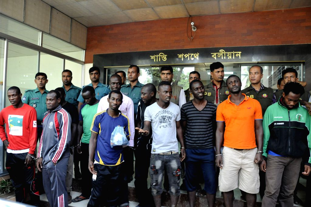 Detective police arrest foreign nationals in Dhaka, Bangladesh, Nov. 14, 2014. Bangladesh Detective police detained 31 foreign nationals on charge of undocumented immigrant living in ...