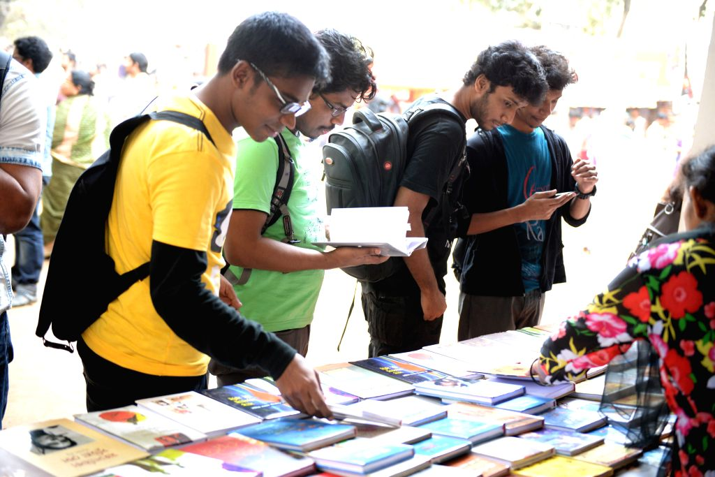 Visitors select books at a stall during the Amar Ekushy Book Fair in Dhaka, Bangladesh, Feb. 10, 2015. The Amar Ekushey Boi Mela, the largest book fair in Bangladesh,