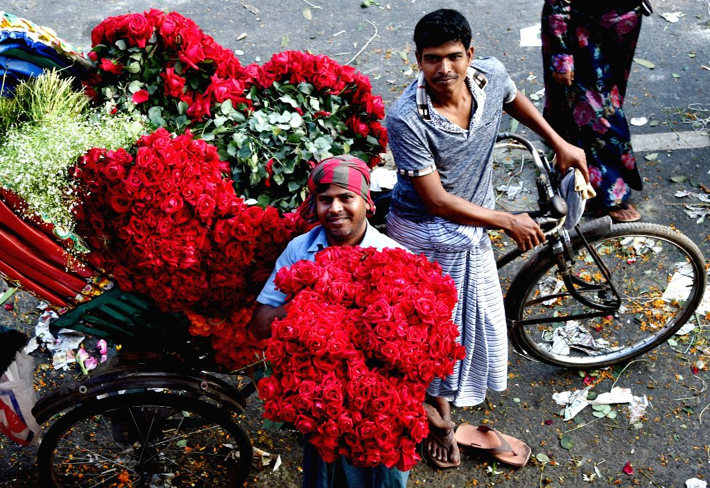 DHAKA, Feb.12, 2019 - A rickshaw puller carries roses to a morning market in Dhaka, Bangladesh, on Feb. 12, 2019. The Valentine's Day is marked annually on Feb. 14.