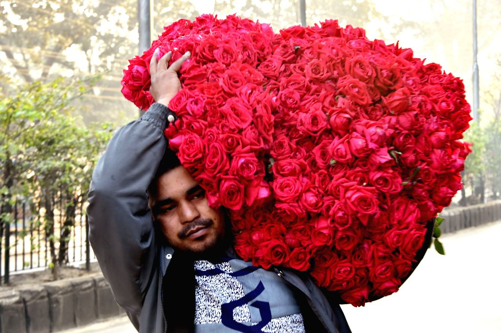 DHAKA, Feb.12, 2019 - A trader carrying roses for the upcoming Valentine's Day is seen in a morning market in Dhaka, Bangladesh, on Feb. 12, 2019. The Valentine's Day is marked annually on Feb. 14.