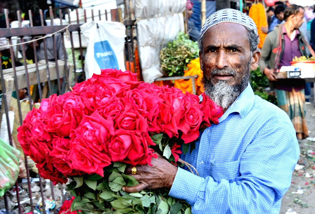 DHAKA, Feb.12, 2019 - A trader holding roses for the upcoming Valentine's Day is seen in a morning market in Dhaka, Bangladesh, on Feb. 12, 2019. The Valentine's Day is marked annually on Feb. 14.