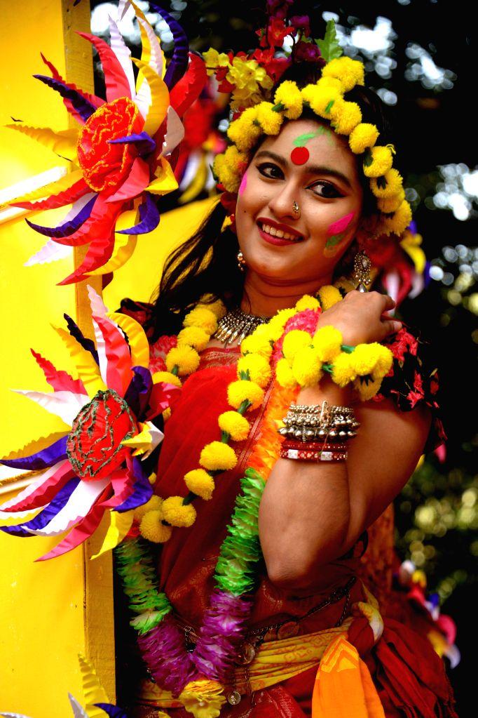 DHAKA, Feb. 13, 2018 - A Bangladeshi young woman decorates herself with natural flowers to celebrate the Pahela Falgun festival in Dhaka, Bangladesh, Feb. 13, 2018. Bangladeshi people Tuesday ...