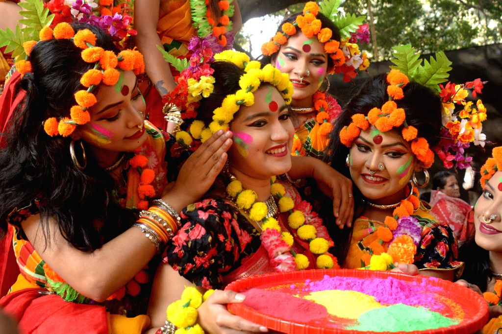 DHAKA, Feb. 13, 2018 - A young Bangladeshi woman smiles as her two fellows apply colored powder on her face during celebrations of the Pahela Falgun festival in Dhaka, Bangladesh, Feb. 13, 2018. ...