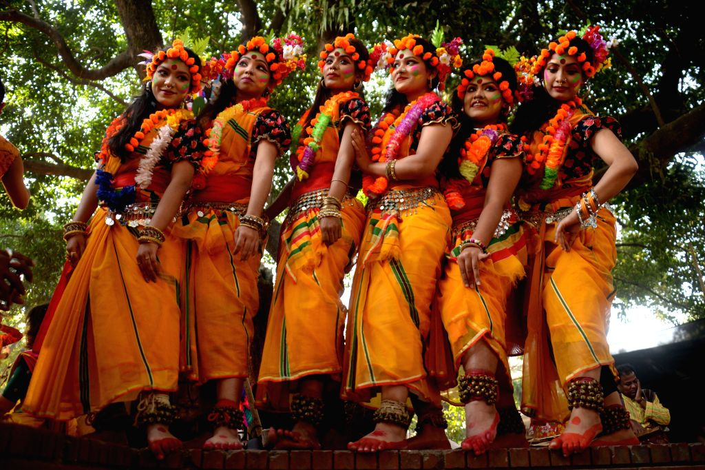 DHAKA, Feb. 13, 2018 - Bangladeshi young women pose for pictures while celebrating the Pahela Falgun festival in Dhaka, Bangladesh, Feb. 13, 2018. Bangladeshi people Tuesday celebrated Pohela Falgun, ...