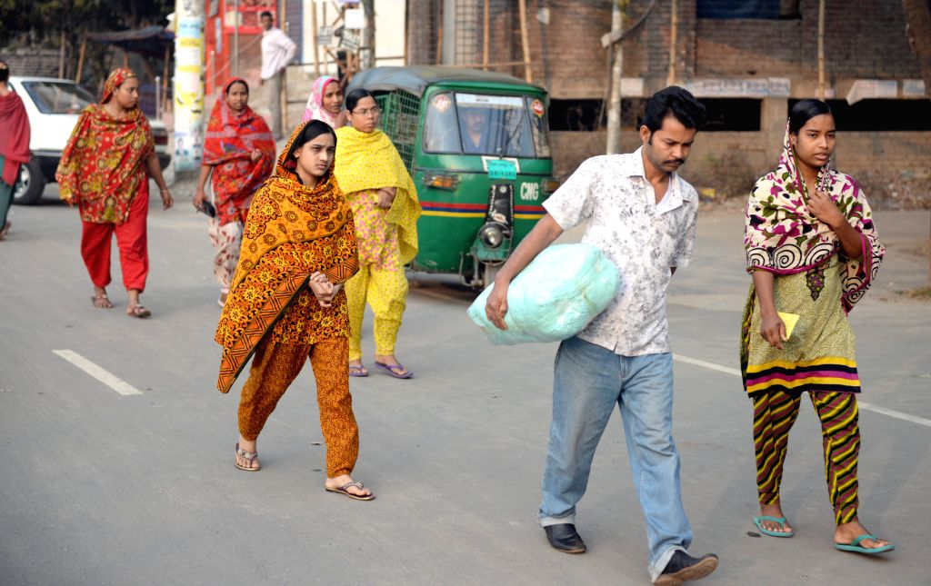 Commuters walk on a street during the ongoing blockade called by the Bangladesh Nationalist Party (BNP)-led alliance in Dhaka, Bangladesh, Feb 16, 2015. Thousands of . - Khaleda Z