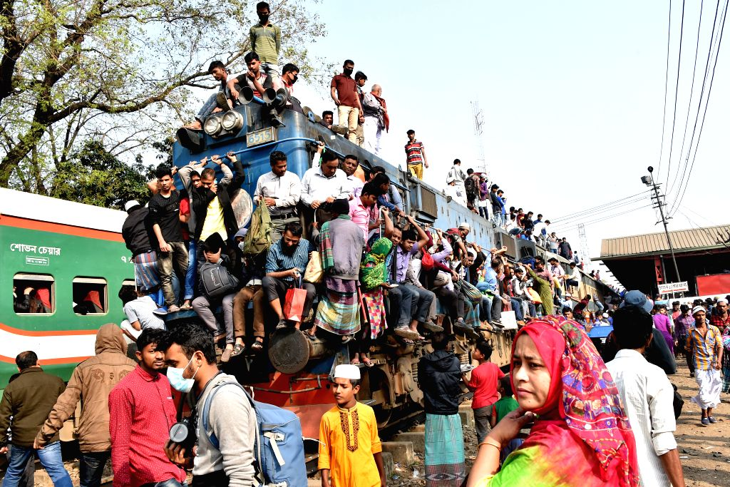 DHAKA, Feb. 20, 2019 - An overcrowded train leaves station after concluding prayers at Ijtema venue in Tongi on the outskirts of Dhaka, Bangladesh, Feb. 19, 2019. The annual Muslim congregation ...