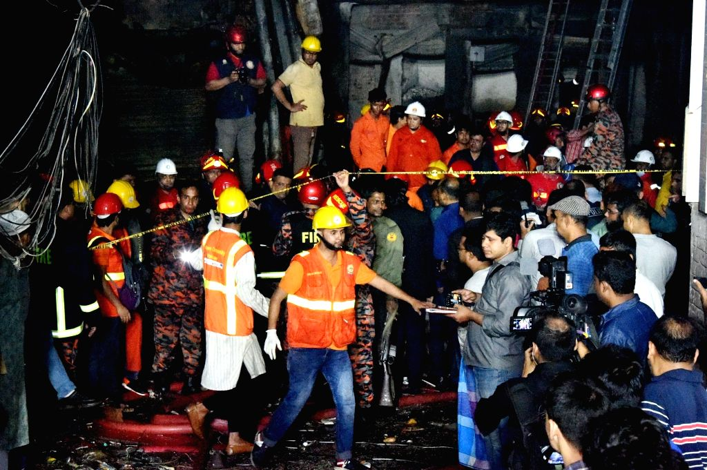 DHAKA, Feb  21, 2019 - Rescuers work at a fire site in Dhaka, Bangladesh, Feb. 21, 2019. At least 40 people were killed and scores injured in a fire that ripped through a building in Bangladesh ...