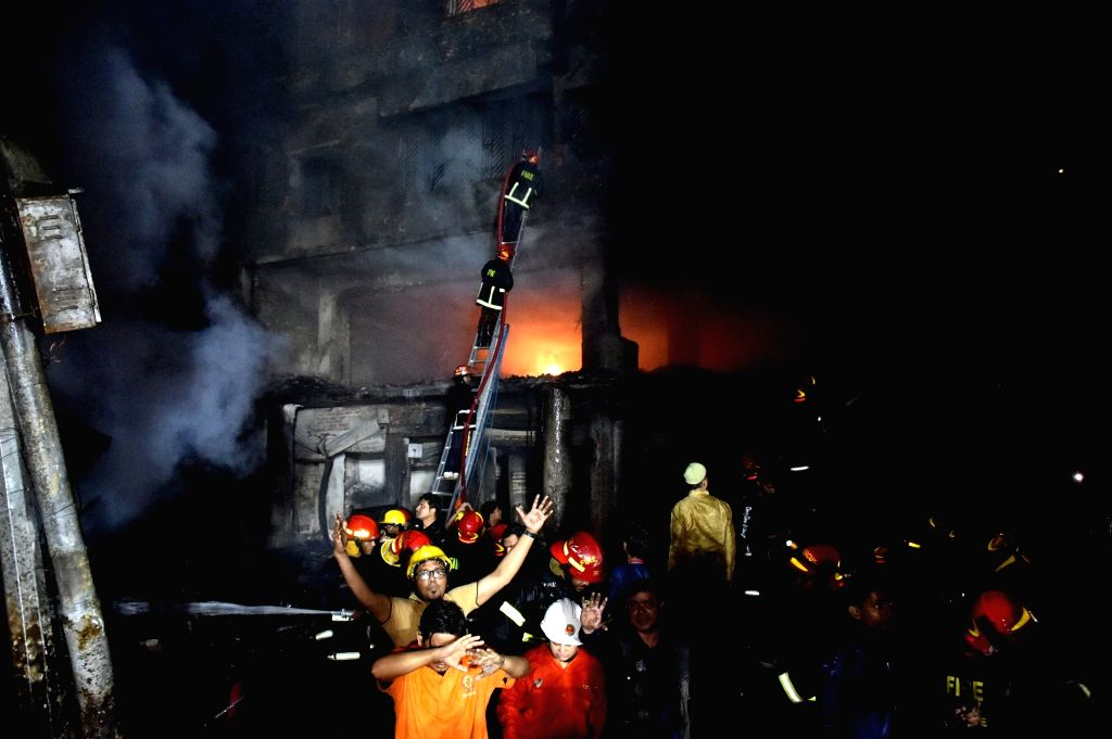 DHAKA, Feb. 21, 2019 - Rescuers work at a fire site in Dhaka, Bangladesh, Feb. 21, 2019. At least 40 people were killed and scores injured in a fire that ripped through a building in Bangladesh ...