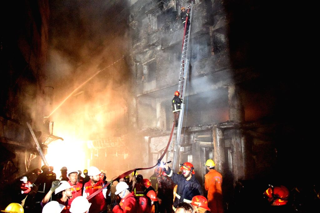 DHAKA, Feb  21, 2019 (Xinhua)  Rescuers work at a fire site in Dhaka, Bangladesh, Feb. 21, 2019. At least 40 people were killed and scores injured in a fire that ripped through a building in Bangladesh capital Dhaka Wednesday night, local media repor
