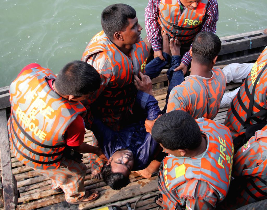 Rescuers retrieve a body of a victim after a ferry accident on the Padma River in Manikganj district, Bangladesh, Feb. 22, 2015. Death toll in Bangladesh's ferry ...