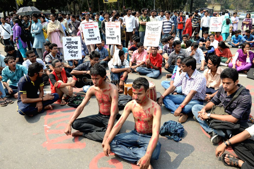 Social activists, bloggers and writers attend a protest demanding the arrest of the killer at Dhaka University area in Dhaka, Bangladesh, Feb. 27, 2015. Unknown ...