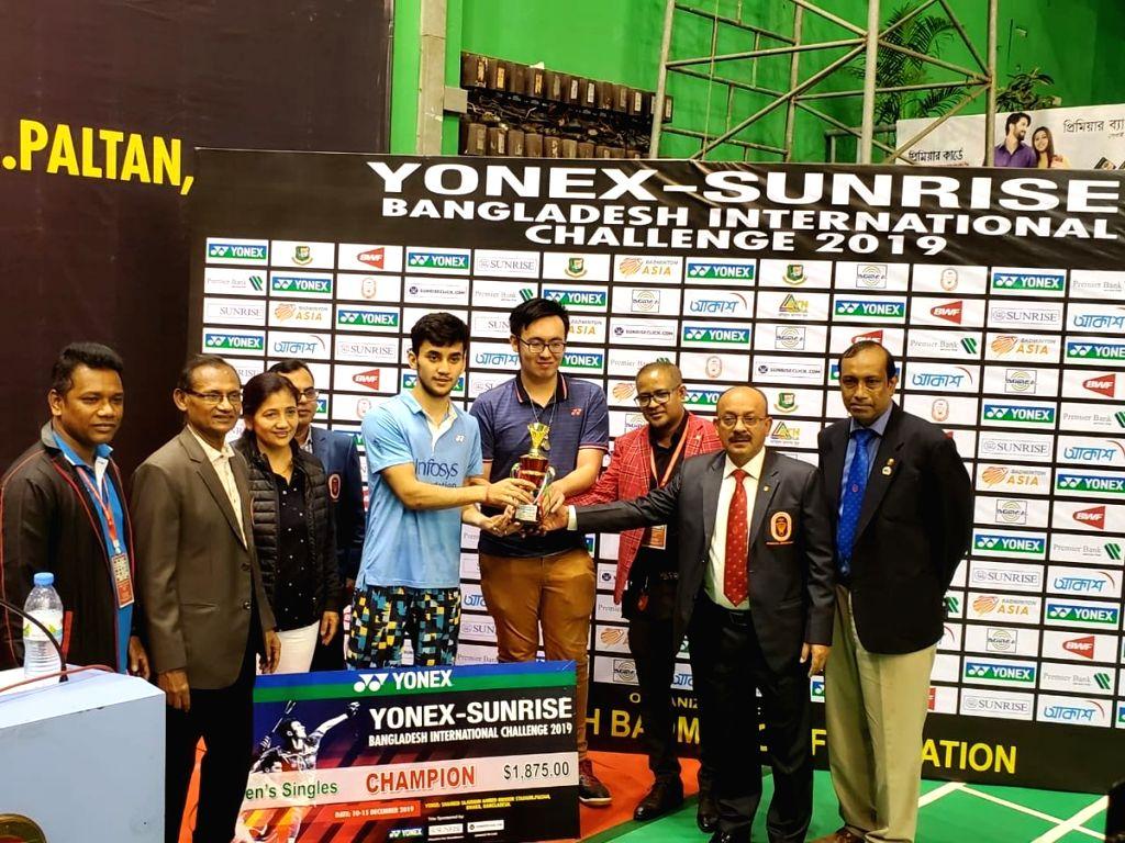 Dhaka: Indian shuttler Lakshya Sen recieves the winning tropy during the medal ceremony of the Bangladesh International Challenge in Dhaka, Bangladesh on Dec 15, 2019. (Photo: IANS)