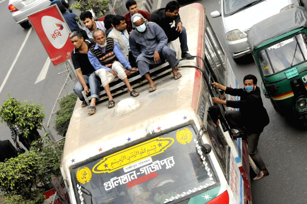 Commuters try to get on a bus during the rally called by the Bangladesh Nationalist Party (BNP) in Dhaka, Bangladesh, Jan. 5, 2014. Bangladeshi Ex-Prime Minister ... - Khaleda Zia
