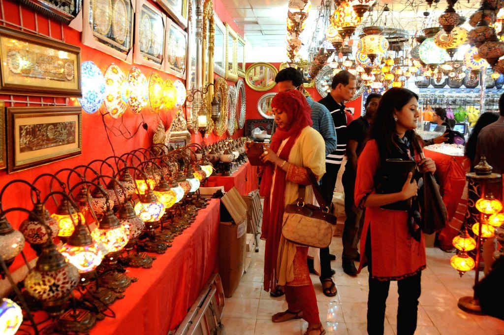 Bangladeshi people visit the Dhaka International Trade Fair in Dhaka, Bangladesh, Jan. 4, 2015. The Dhaka International Trade Fair held in Dhaka lasts from Jan. 1 to ..