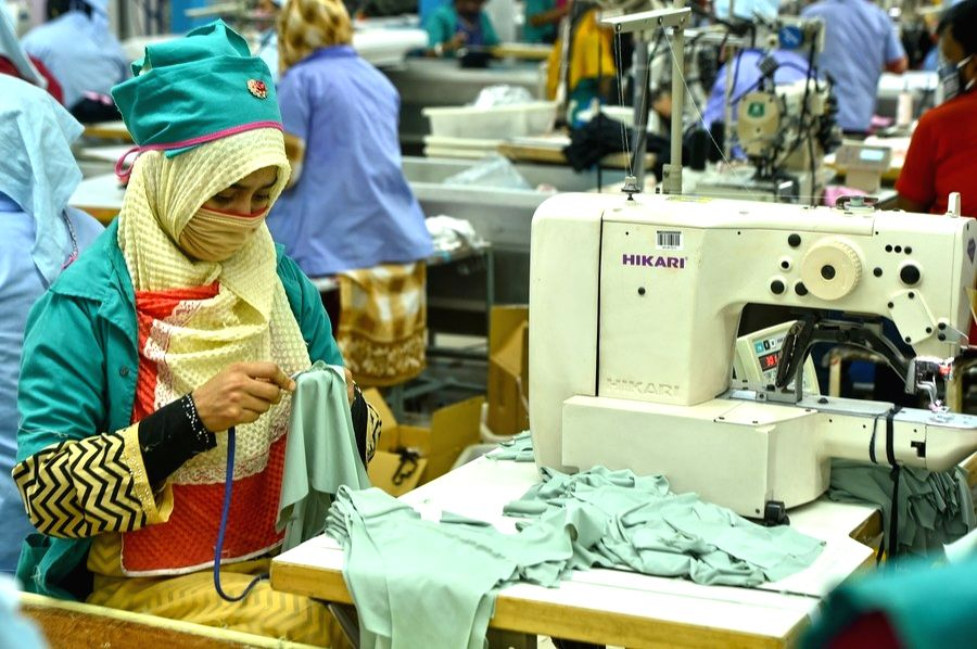 Dhaka, Jan. 6 (Xinhua) -- A young woman wearing a face mask works at Liz Fashion Industry Limited, a garment manufacturer, in Gazipur on the outskirts of Dhaka, Bangladesh on Jan. 3, 2021. (Xinhua/IANS)