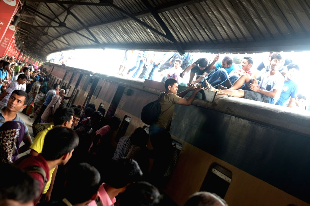 DHAKA, July 1, 2016 - Passengers try to climb on top of a train leaving for their hometowns for the upcoming Eid al-Fitr festival in Dhaka, Bangladesh, July 1, 2016.