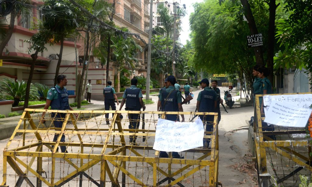 DHAKA, July 10, 2016 - Bangladeshi policemen stand guard near the Spanish restaurant where the militant attack took place in Dhaka, Bangladesh, July 10, 2016. After a video where three ...