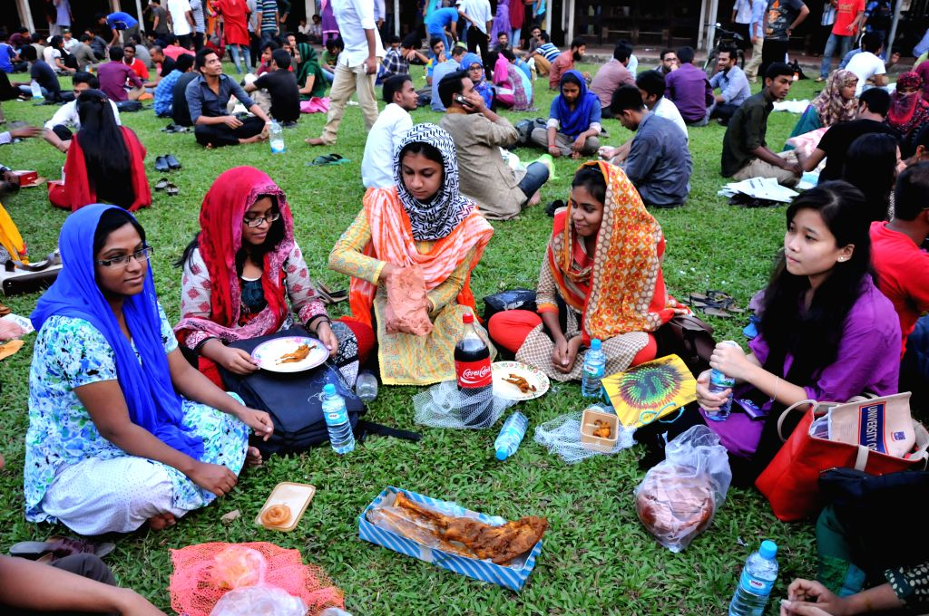 Students of Dhaka University wait to break their fast during Islamic holy month of Ramadan at the Dhaka University campus in Dhaka, Bangladesh, July 10, 2014. ...