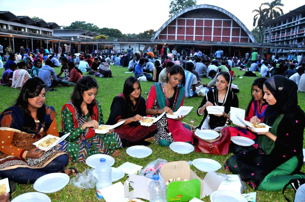 Students of Dhaka University take food after breaking the daytime fast during Islamic holy month of Ramadan at the Dhaka University campus in Dhaka, Bangladesh, July .