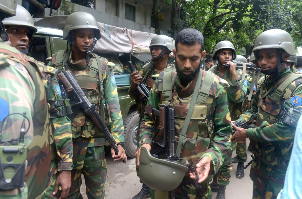 DHAKA, July 2, 2016 - Bangladeshi army personnel stand by during a rescue operation after an attack at a Spanish restaurant in Dhaka's diplomatic enclave Gulshan, Bangladesh, July 2, 2016. Gunmen ...