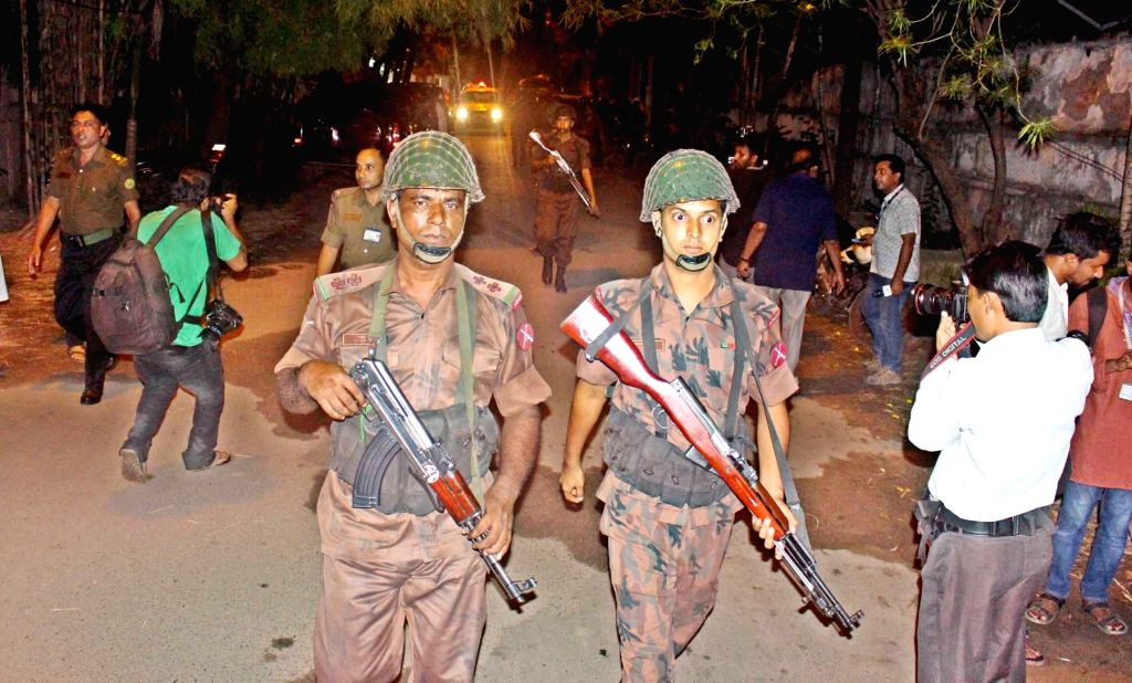 DHAKA, July 2, 2016 - Security personnel patrol near a restaurant attacked by gunmen in Dhaka, Bangladesh, July 2, 2016. Gunmen have shot dead two police officials, police said, in the first attack ...