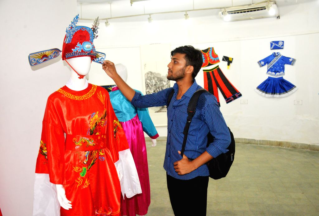 DHAKA, July 22,  2018 - A visitor touches a hat at the exhibition portraying the history and culture of the ancient Silk Road in Zainul Gallery of the Faculty of Fine Arts of Dhaka University (DU) in ...