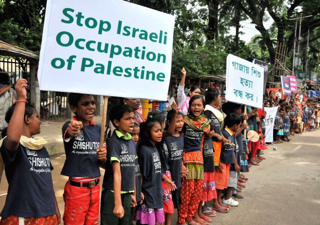 Bangladeshi children shout slogans during a protest against ongoing Israeli air raids on the Gaza Strip in Dhaka, Bangladesh, July 24, 2014. Israeli offensive in the .