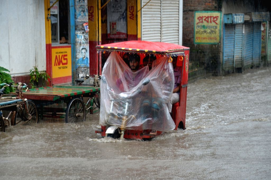 DHAKA, July 25, 2017 - A three-wheeler passes through a waterlogged street at a low lying area in Bangladeshi capital Dhaka on July 25, 2017.