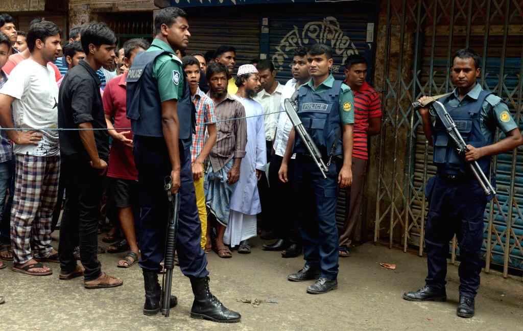 DHAKA, July 26, 2016 - Policemen block the site where nine suspected militants were killed in Dhaka, Bangladesh, on July 26, 2016. Nine suspected militants were killed as Bangladesh law enforcers on ...