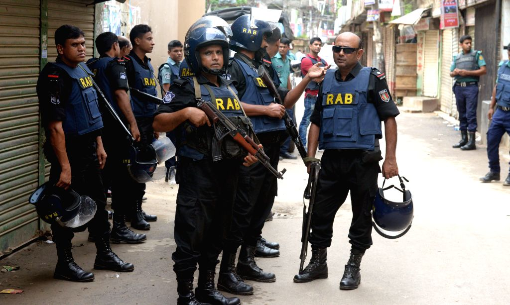 DHAKA, July 26, 2016 - Policemen stand guard at the site where nine suspected militants were killed in Dhaka, Bangladesh, on July 26, 2016. Nine suspected militants were killed as Bangladesh law ...