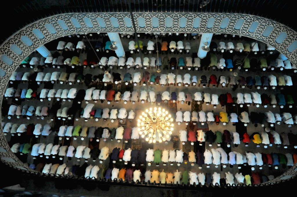 Bangladeshi Muslims offer prayers at the national mosque during the Eid al-Fitr festival in Dhaka, Bangladesh, on July 29, 2014. Bangladeshi Muslims celebrate the Eid