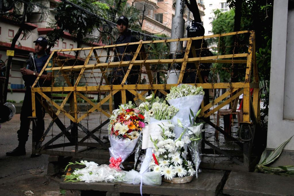 DHAKA, July 3, 2016 - Photo taken on July 3, 2016 shows flowers laid in front of a Spanish restaurant in memory of victims killed in an attack at the Spanish restaurant in Dhaka's diplomatic enclave ...