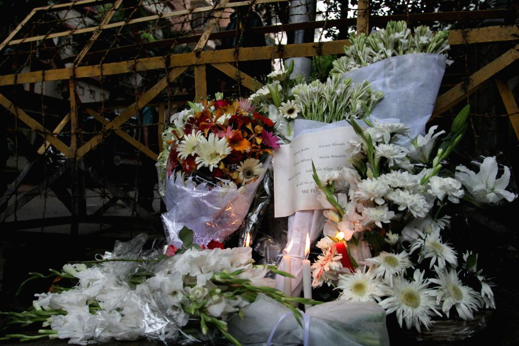 DHAKA, July 3, 2016 - Photo taken on July 3, 2016, shows flowers laid in front of a Spanish restaurant in memory of victims killed in an attack in Dhaka's diplomatic enclave Gulshan, Bangladesh, July ...